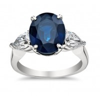 9.33 ct Oval Shape Sapphire With Pear Shape Diamond Anniversary Ring